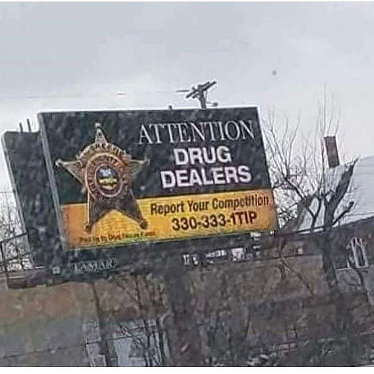 This billboard has just went viral posted in #Ohio so you think other Drug dealers would really report the competition?