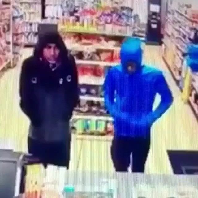 Two people attempted a robbery with a fake gun and was caught shot by a security guard with a real one.